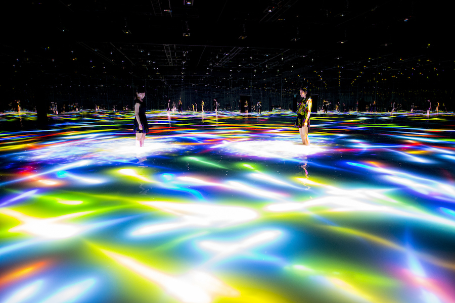 Drawing on the Water Surface Created by the Dance of Koi and People by TeamLab