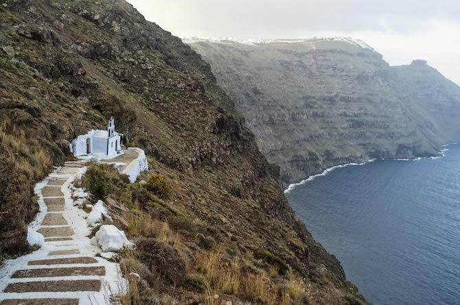 """Photographer Petros Koublis describes the Santorini that he captures as the """"equivalent of a dream""""—which is exactly what it feels like to view his photographs—like looking through the lens of a dream."""