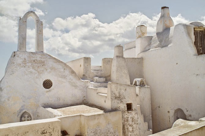 "Photographer Petros Koublis describes the Santorini that he captures as the ""equivalent of a dream""—which is exactly what it feels like to view his photographs—like looking through the lens of a dream."