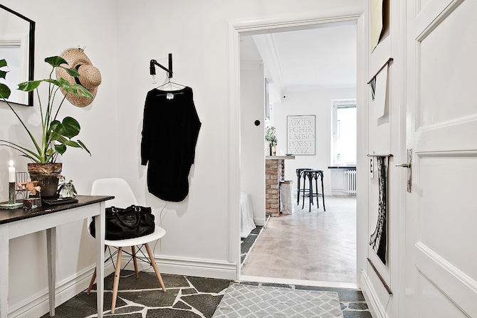 This studio apartment is the perfect example of how thoughtful planning and specific furniture choices can make space feel more open and spacious.