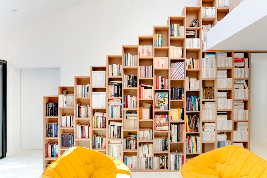 A Stunning, Bright Home in Paris by Andrea Mosca with a staircase bookshelf design