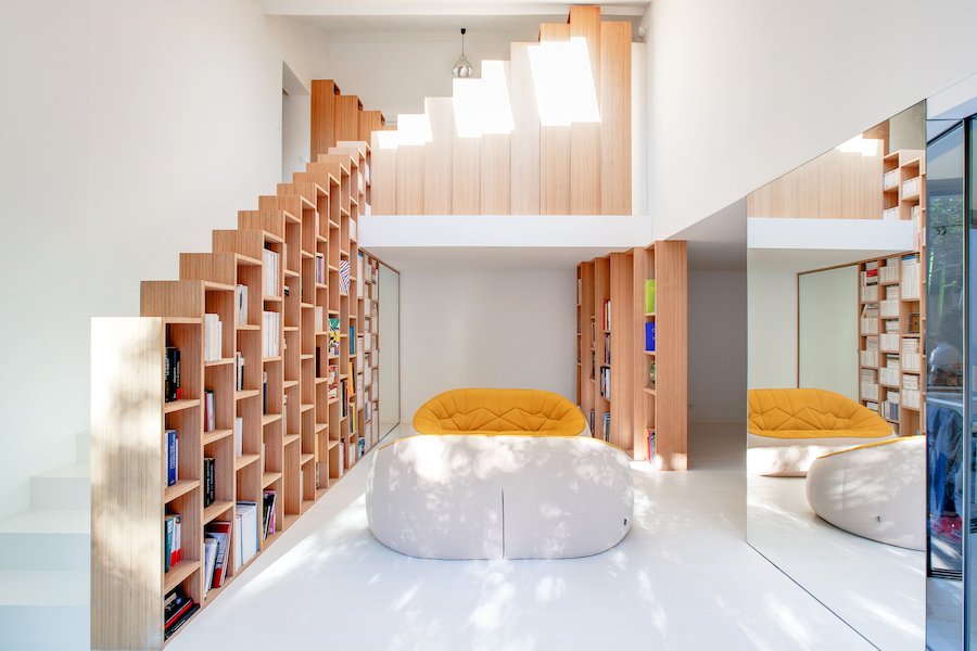 A Stunning, Bright Home in Paris by Andrea Mosca with a staircase bookshelf
