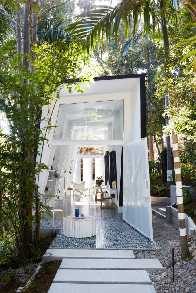 Inspired by the concept of a shack, Marc&Co created this studio office in a subtropical garden for interior styling firm Indigo Jungle.